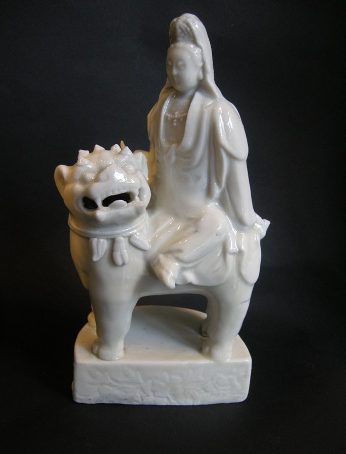 Figure showing a guanyin seated on a buddhist lion in blanc de chine porcelain | MasterArt