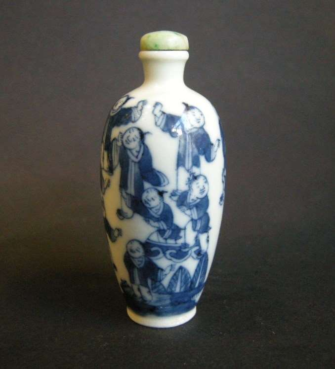 Porcelain snuff bottle blue and white decorated with childrens games