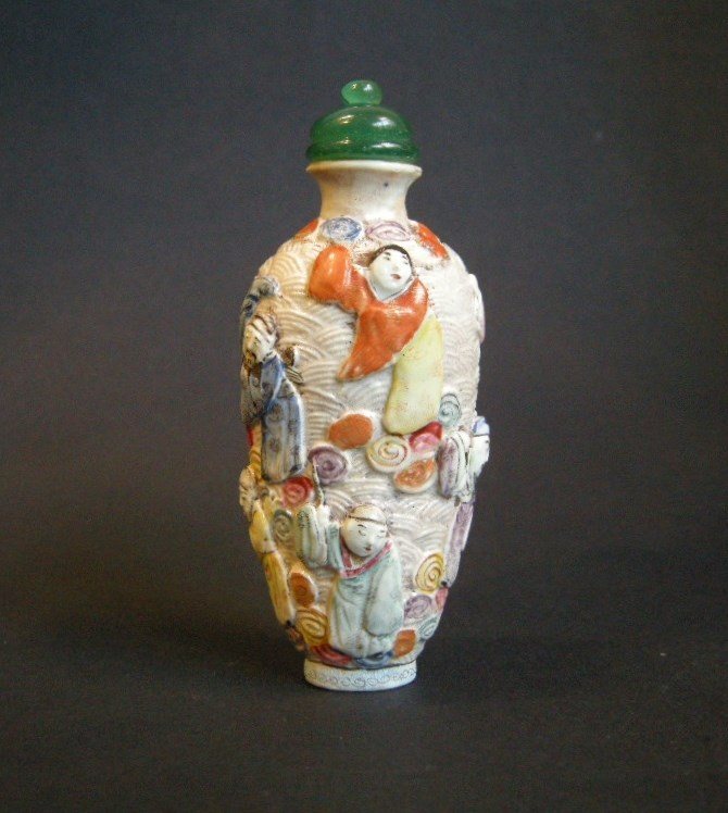 Porcelain snuff bottle molded and sculpted with eight immortals