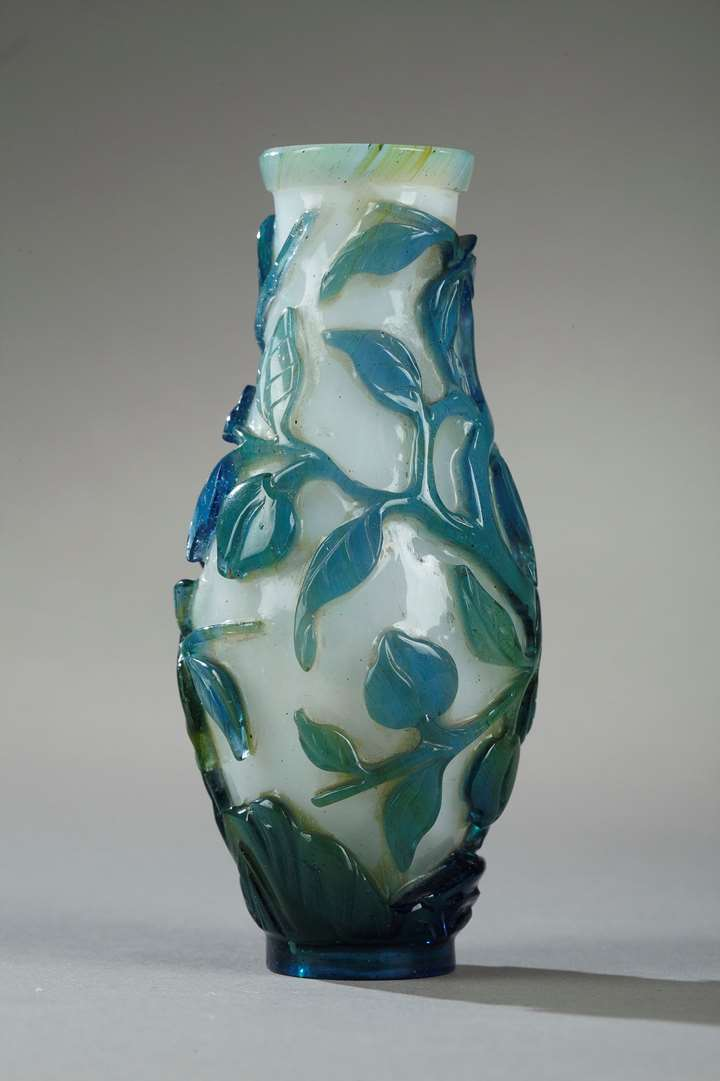 Small vase overlay glass turquoise blue, green on ground white opaque decorated with longevity peach and foliage