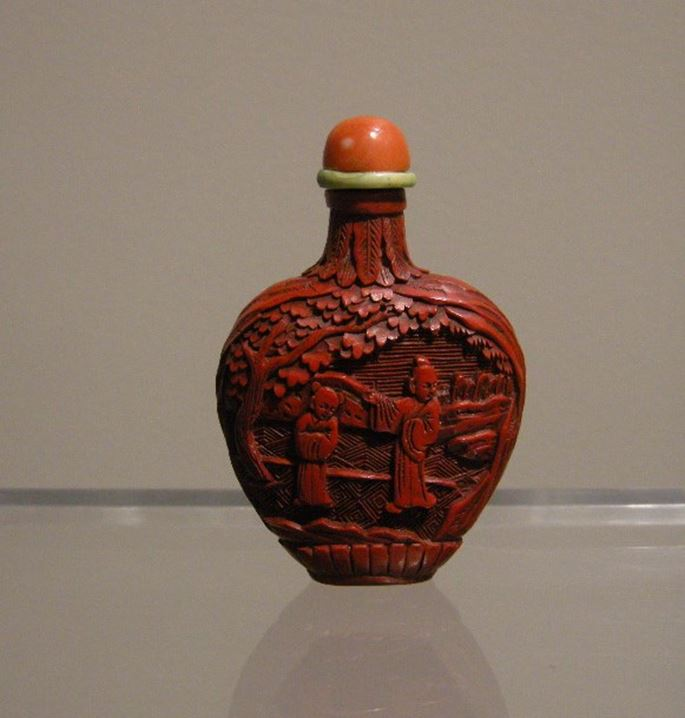 Snuff bottle cinabar lacquer sculpted with figures in a landscape | MasterArt