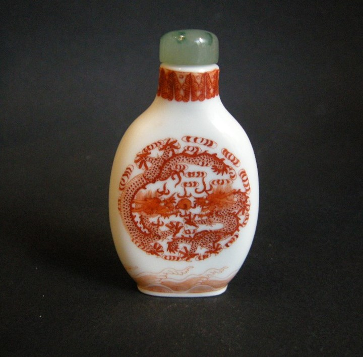 Snuff bottle porcelain decorated in iron red  with two dragons on each side