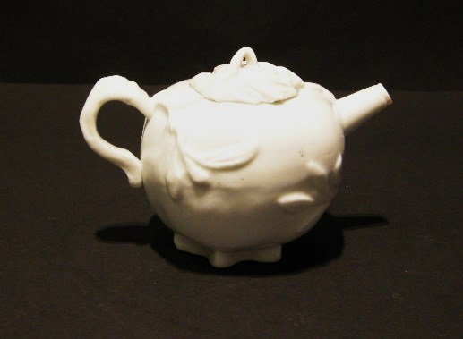 Winepot; blanc de chine porcelain in the form of a pomegranate. Dehua kilns Fujian province - Kangxi period