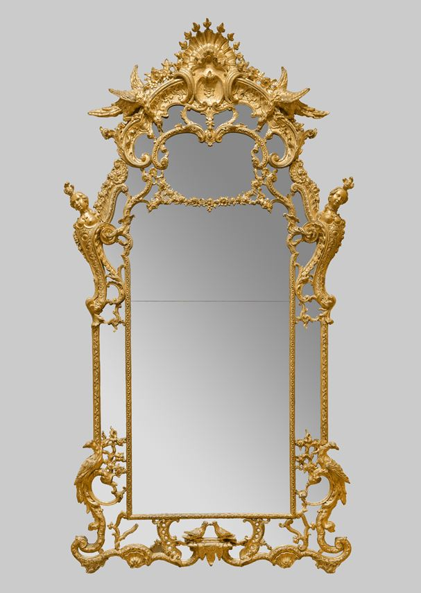 Exceptional and large mirror in carved and gilt wood, adorned with ducks, busts of women, phoenix and turtle doves | MasterArt