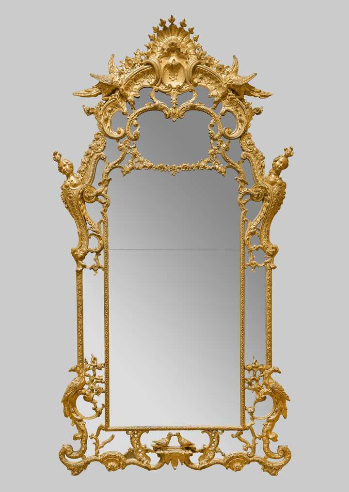 Exceptional and large mirror in carved and gilt wood, adorned with ducks, busts of women, phoenix and turtle doves