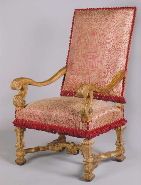 A RARE AND EXCEPTIONAL PAIR OF LOUIS XIV SCULPETED GILTWOOD ARMCHAIRS