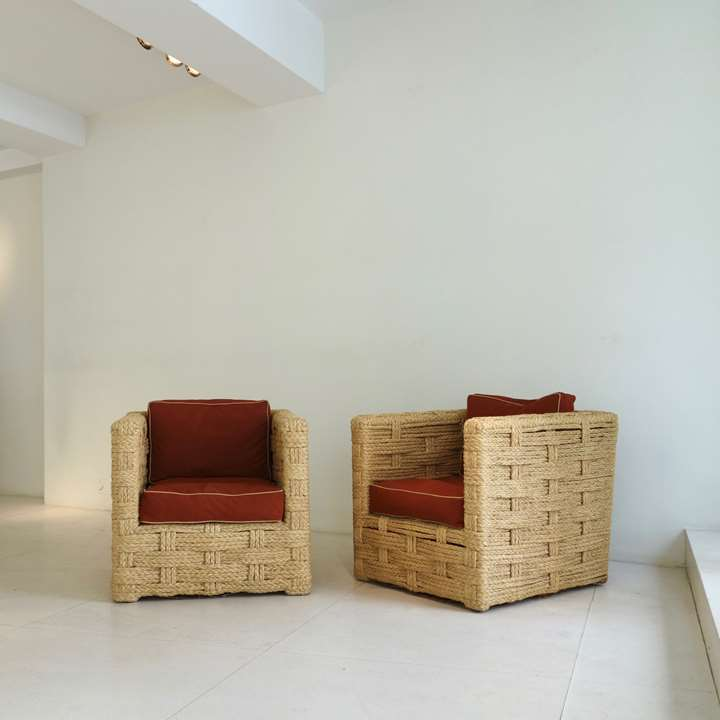 Pair of chairs, wooden structure trimmed with braided raffia