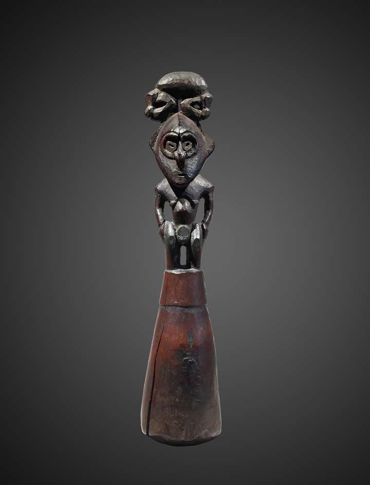 A food pounder representing a male ancestor figure.