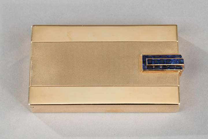 A French art deco jewelled gold vanity case