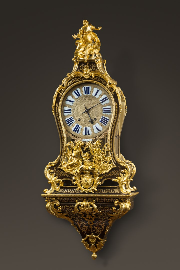 A REGENCE ORMOLU-MOUNTED BOULLE MARQUETRY CARTEL-CLOCK ON BRACKET