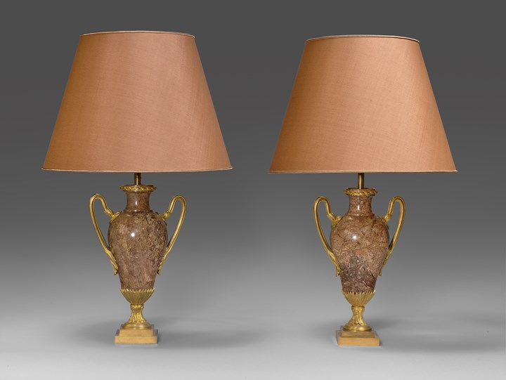 A pair of neoclassical marble vases, mounted as lamps
