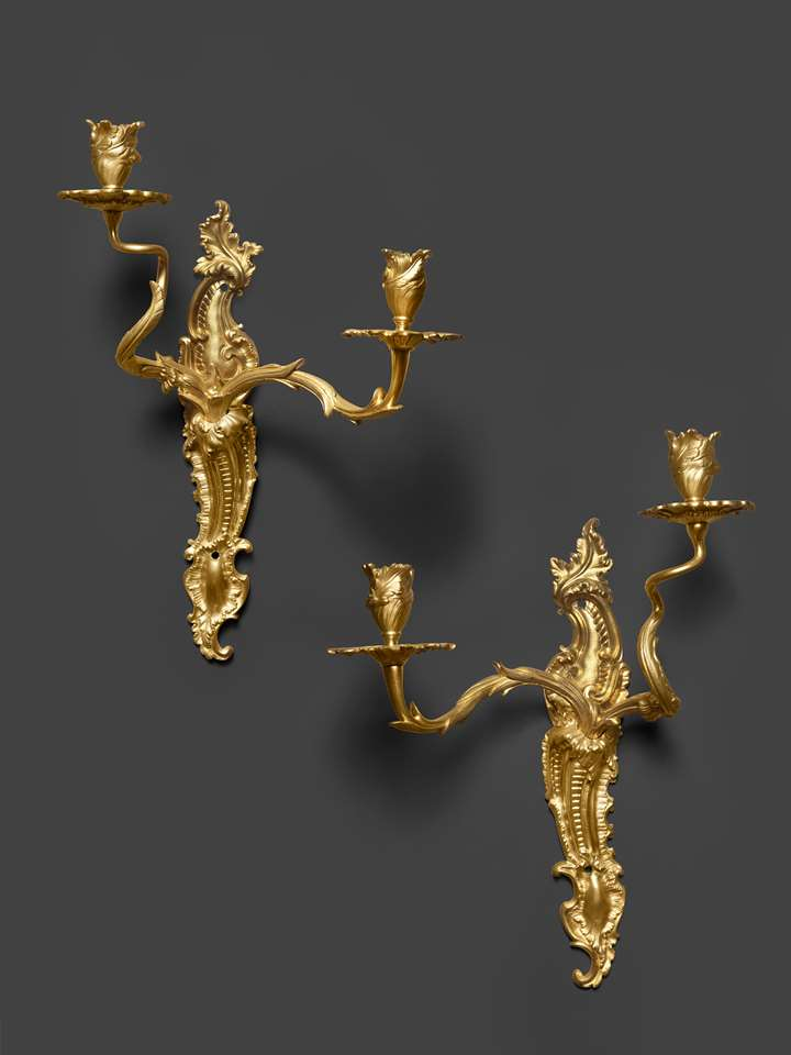 A paire of early Louis XV ormolu two-light wall-lights