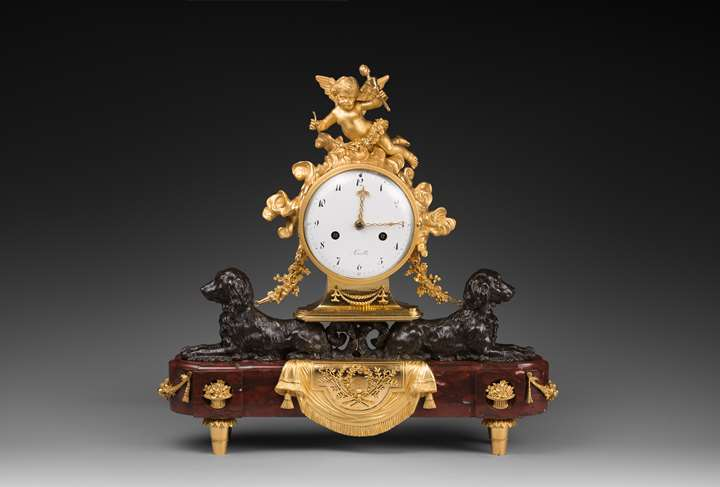 Louis XVI patinated and gilded bronze clock