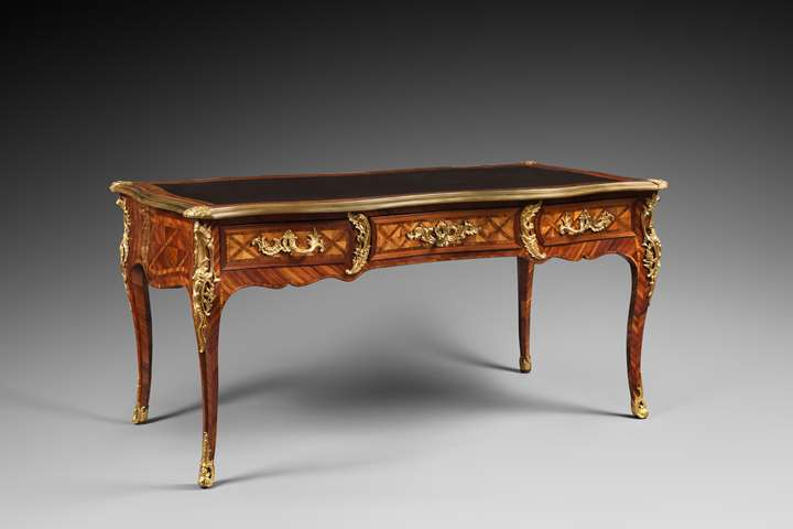 A Louis XV ormolu-mounted satinated wood and Kingwood bureau plat