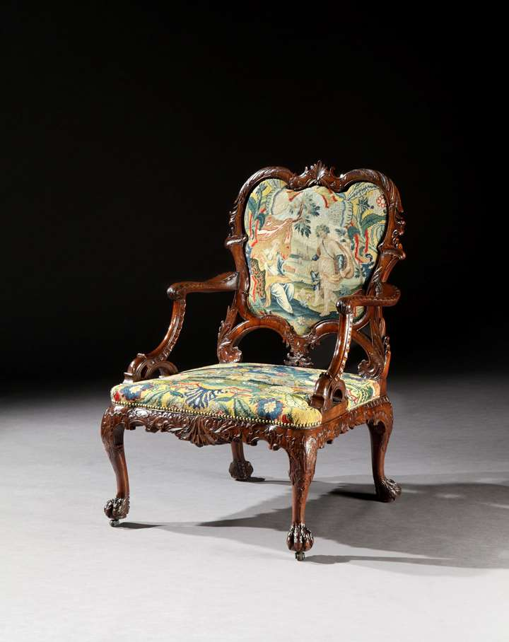 A rare George II period carved mahogany armchair