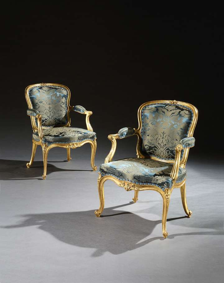 An Exceptional Pair of Giltwood Cabriole Armchairs