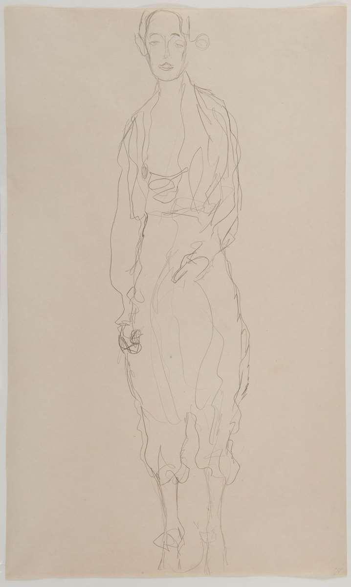 Portrait d'une femme debout en pantalon