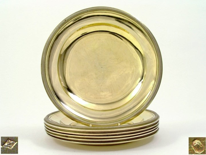 A Set of Six French Silver Gilt Dinner Plates