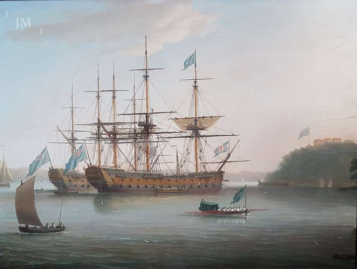 Two First-Rates at anchor, with the foreground ship and barge flying the flag of the Vice-Admiral of the Blue
