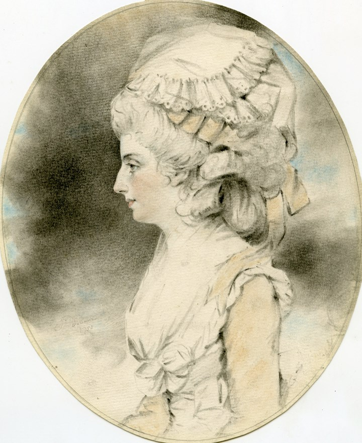 A portrait of a young girl in profile in a mob cap