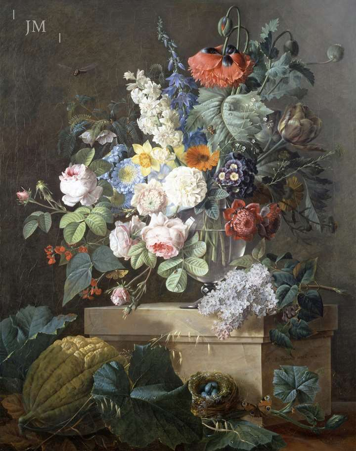 A bouquet of flowers on a marble entablature