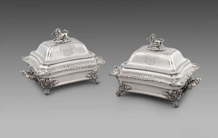A Pair of Victorian Entrée Dishes & Covers on Sheffield-Plate Warming Stands
