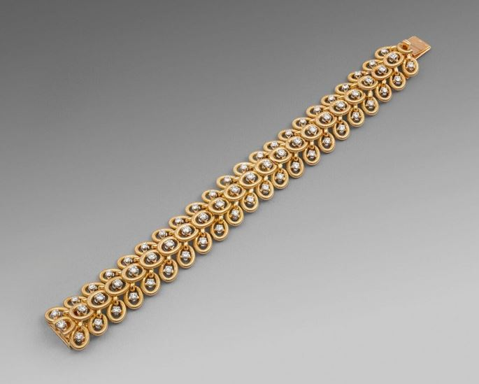 Cartier - A Gold & Diamond Strap Bracelet with Interlink Circles  | MasterArt