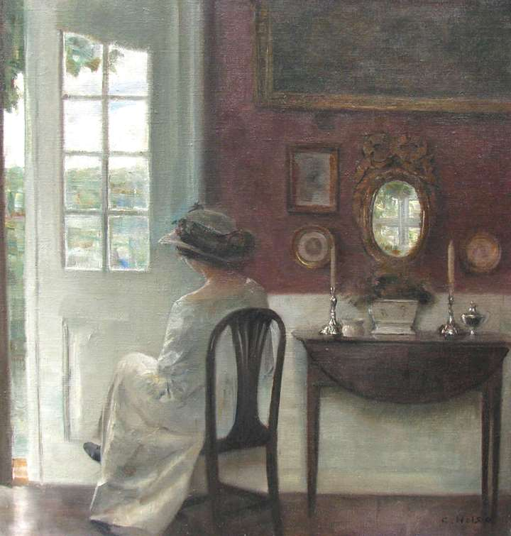 Interior with a young woman sitting next to the garden door