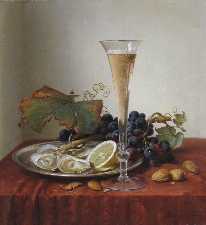 Grapes, oysters, almonds and a Champagne flute on a draped ledge