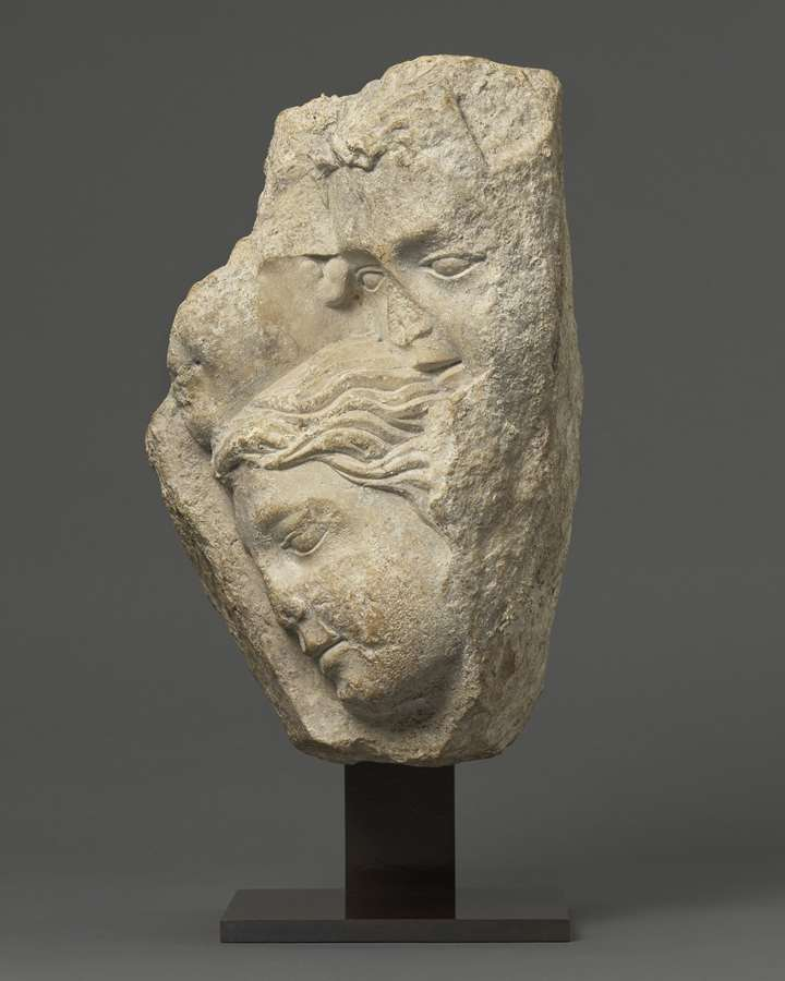 Relief with Group of Faces