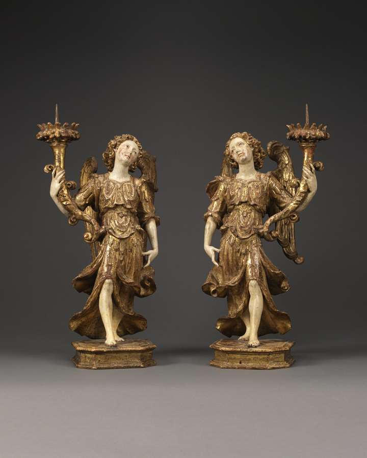 A Pair of Angels Holding Candlesticks