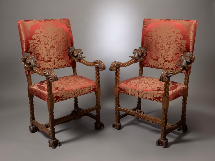 A Pair of Baroque Carved Armchairs