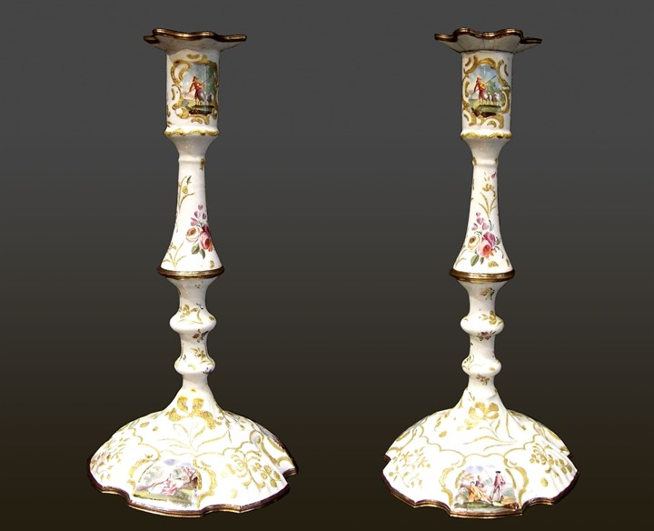 A Pair of George II Battersea Enamel Candlesticks