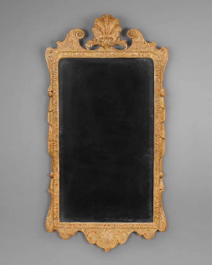 A GEORGE I CARVED GESSO AND GILTWOOD WALL MIRROR