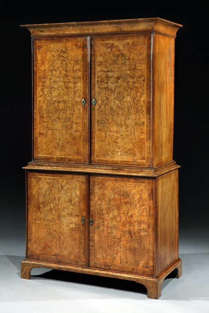 A GEORGE I WALNUT CABINET