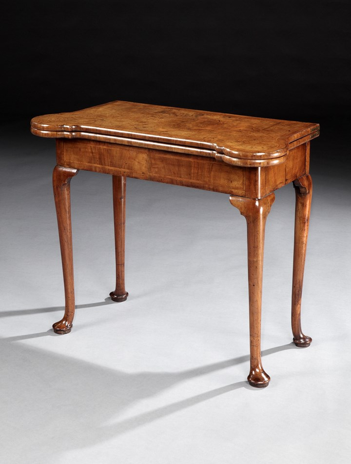 A GEORGE I WALNUT CARD TABLE