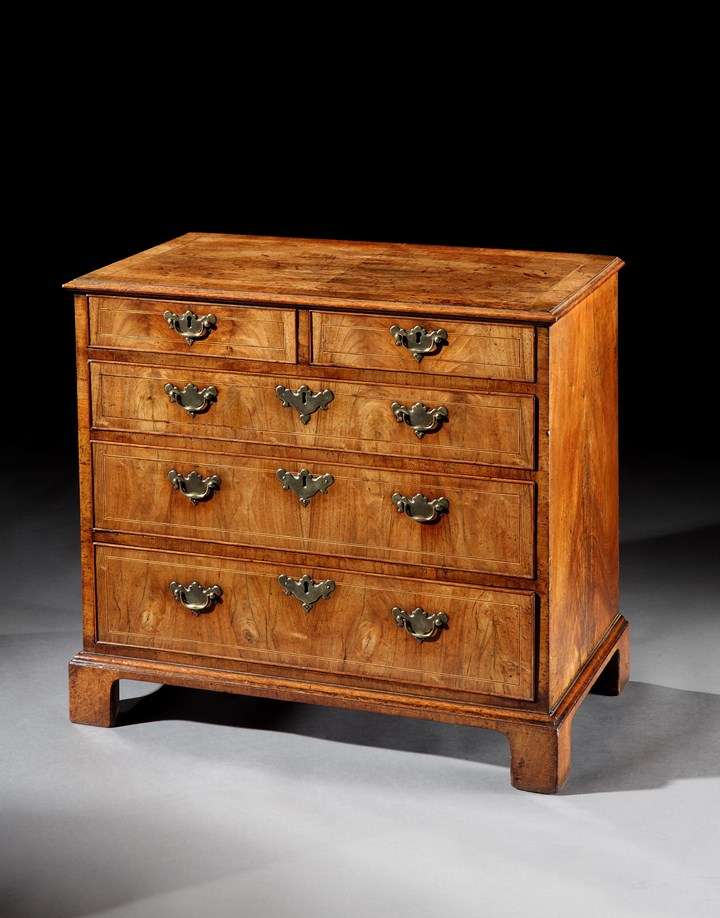 A GEORGE I WALNUT CHEST OF DRAWERS