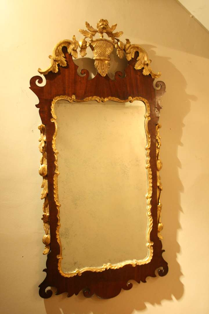 A GEORGE II MAHOGANY AND GILT MIRROR