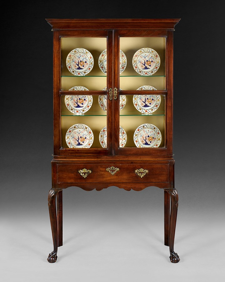 A GEORGE II MAHOGANY CABINET ON STAND