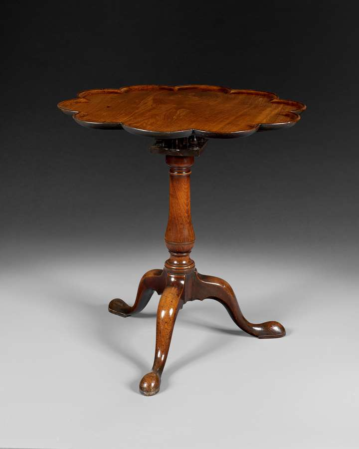 A GEORGE III MAHOGANY SCALLOP TOP TRIPOD TABLE