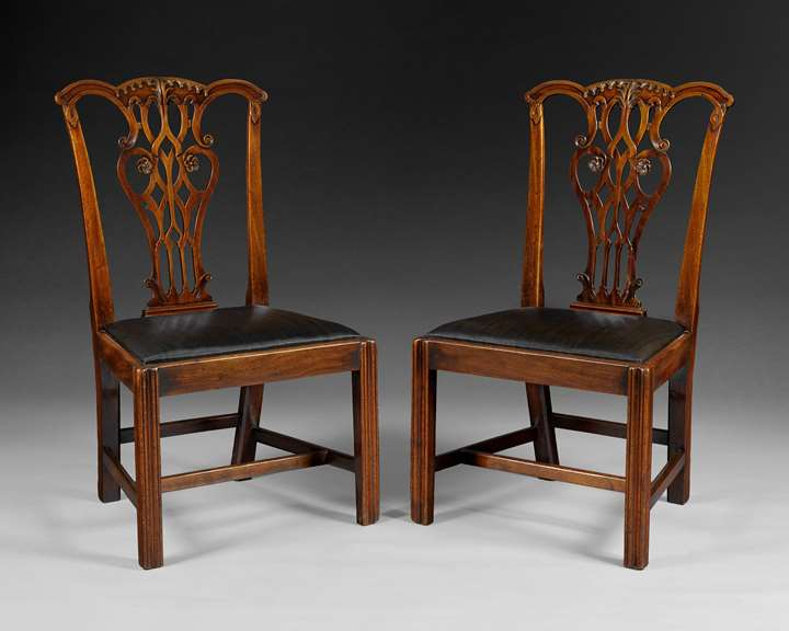 A PAIR OF GEORGE III CHIPPENDALE CARVED MAHOGANY SIDE CHAIRS
