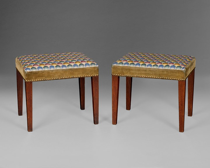 A PAIR OF GEORGE III MAHOGANY STOOLS