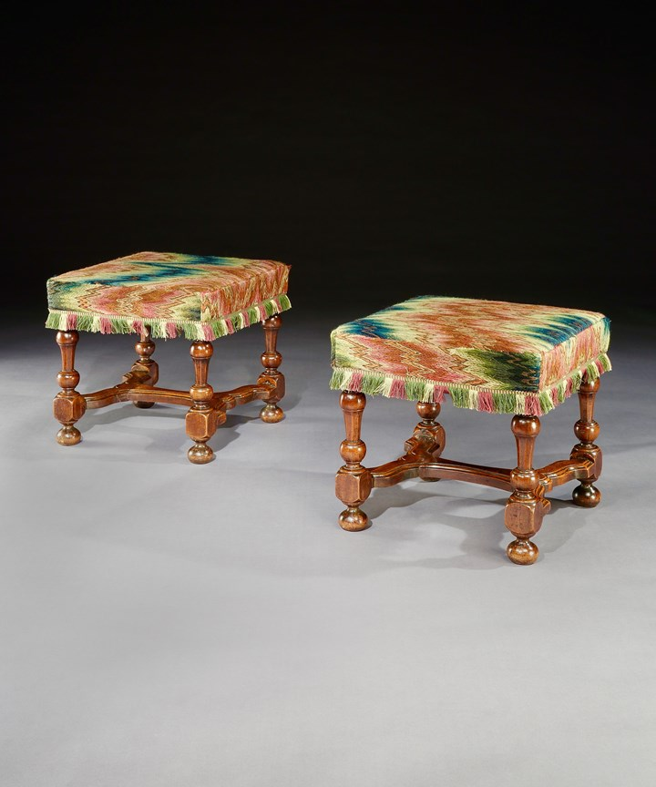 A PAIR OF WILLIAM AND MARY WALNUT STOOLS