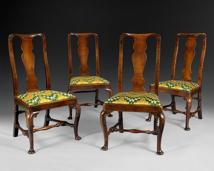 A SET OF FOUR QUEEN ANNE WALNUT CHAIRS