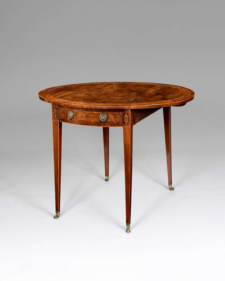A fine George III period oval Pembroke table