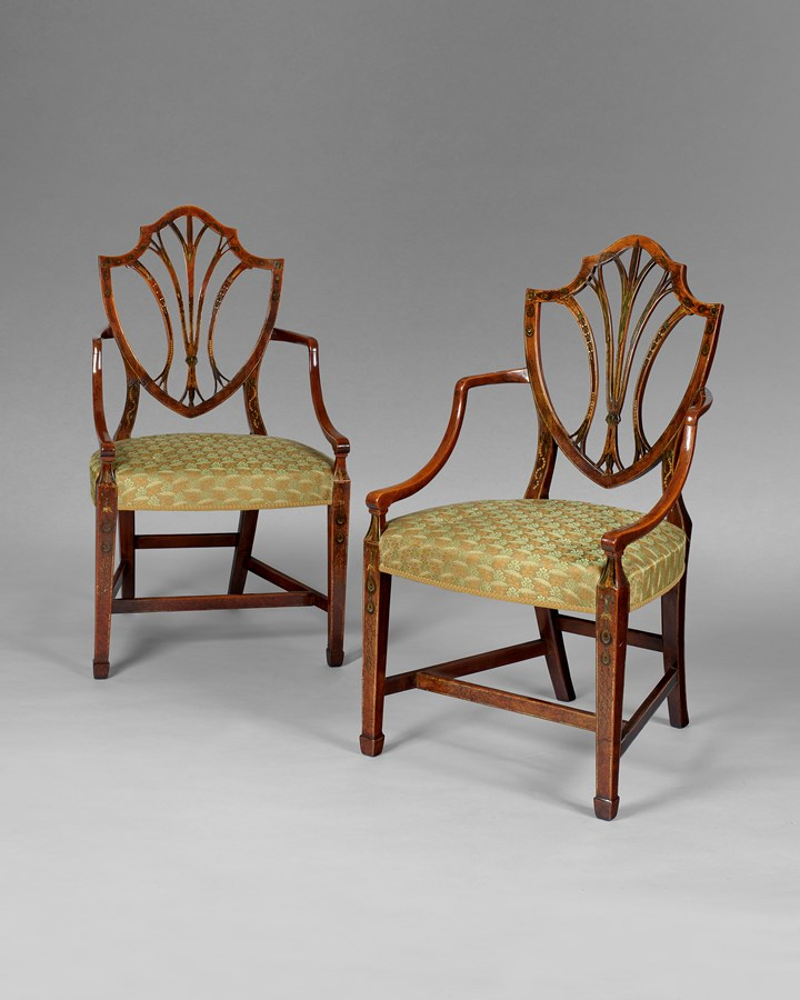 A pair of George III period satinwood shield back armchairs