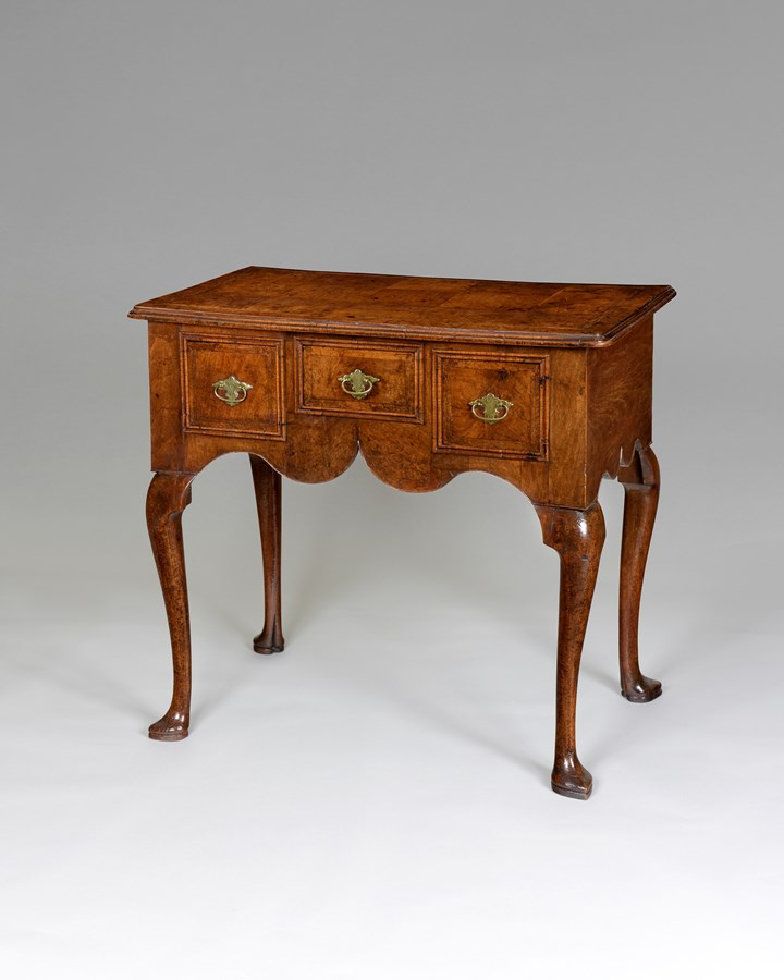 A very good Queen Anne period veneered walnut lowboy