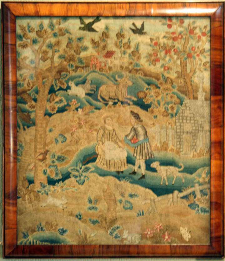 AN EARLY 18TH CENTURY NEEDLEWORK PICTURE