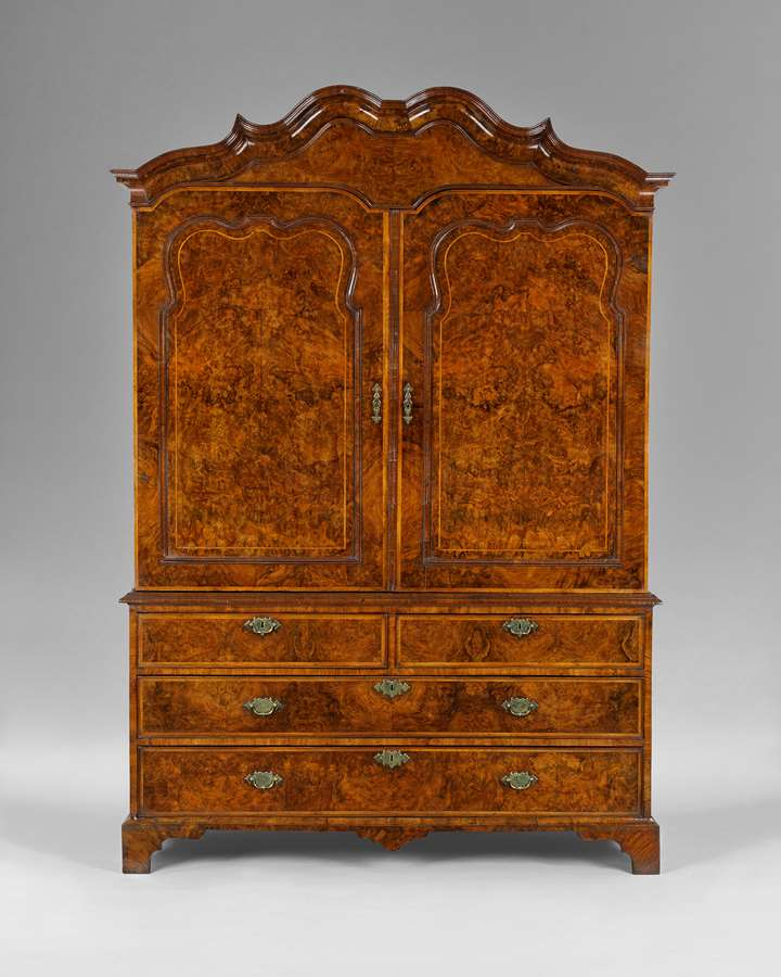 An exceptional George I period burr walnut clothes press