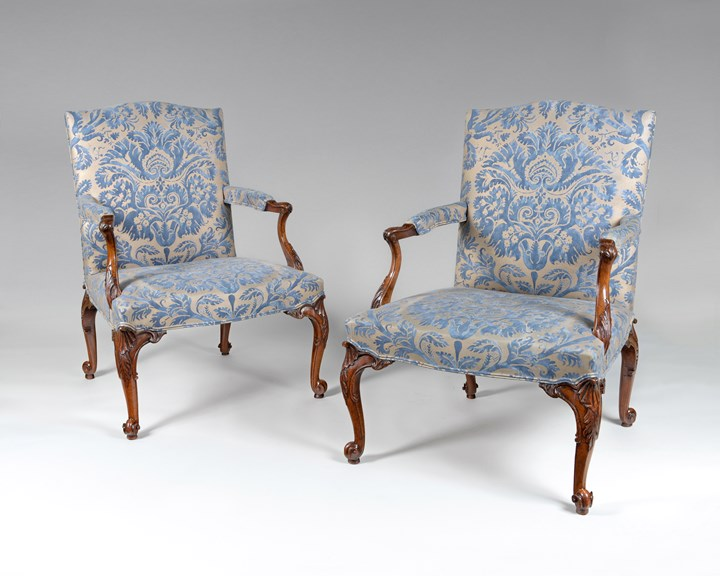 An exceptional PAIR of finely carved walnut Gainsborough armchairs